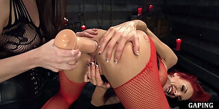 gaping redhead les anally stretched with toy
