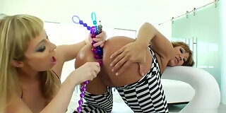 two sluts are fucking in their asses with black cock